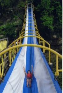 A child going down a pretty big slide